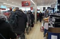 Shoppers queue at Aldi in Roscommon last Thursday as panic buying took hold following the outbreak of Covid-19.